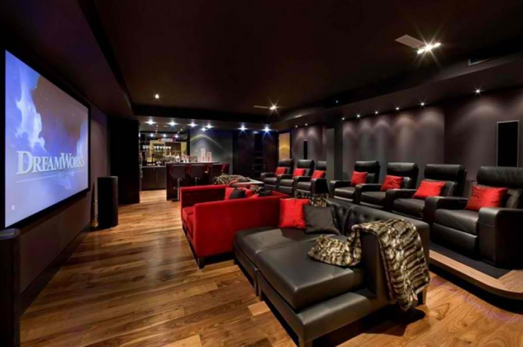home theater with black leather armchairs
