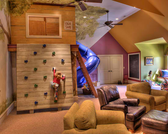 kid's playroom with climbing wall and slide