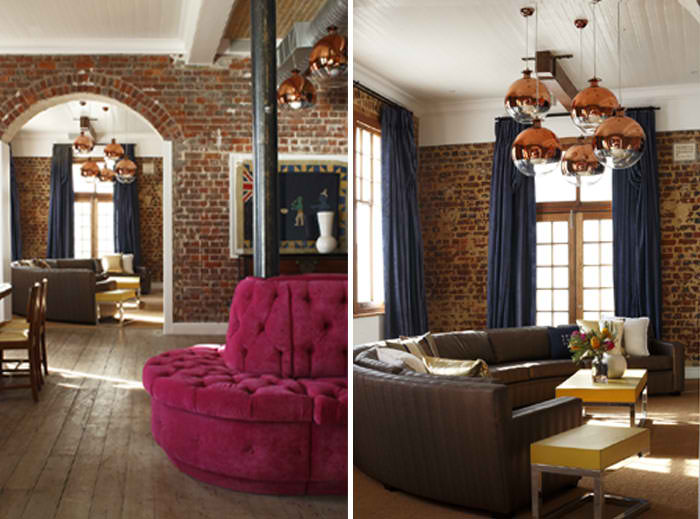 living room with old raw brick walls