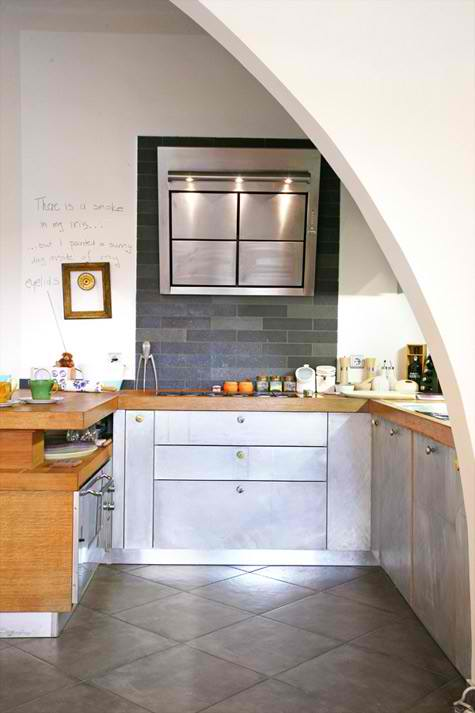 stainless steel cabinets and wood countertop