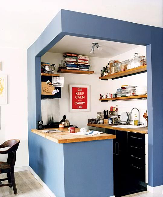 small kitchen in a blue paint