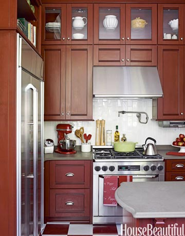 small kitchen design with high cabinets touches the celing