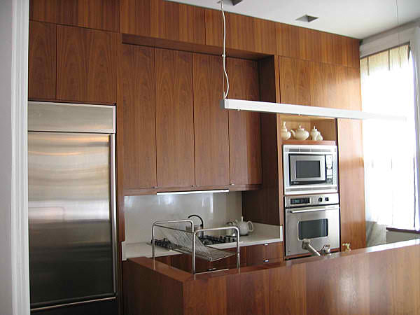 modern  wood small kitchen with high cabinets