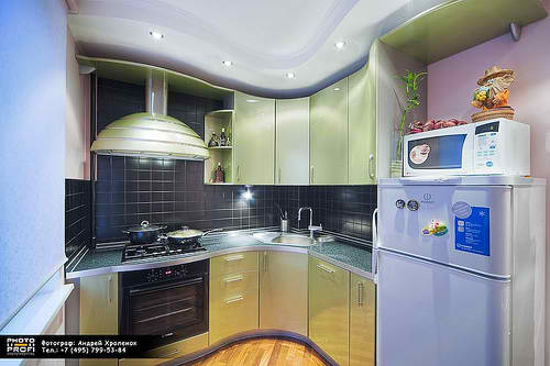 small kitchen design with curved cabinets