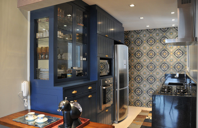 small kitchen design with deep blue cabinets and vintage tiles