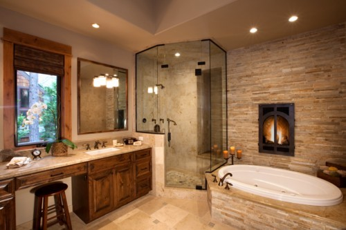 Beau Bathroom Design With Raw Stone Wall And Fireplace