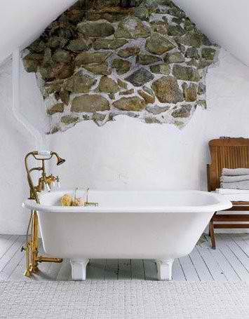 bathroom design with exposed stone