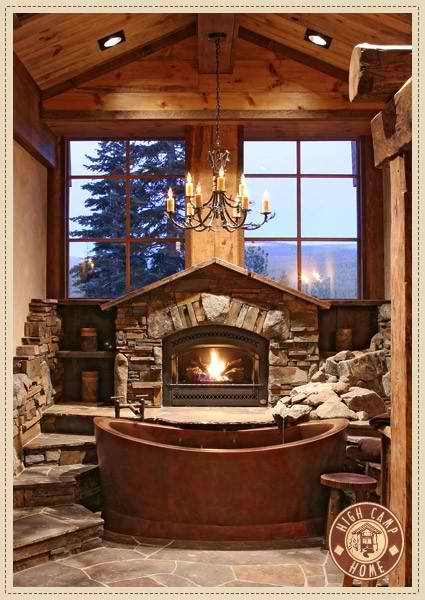stone bathroom design with view fireplace and chandelier