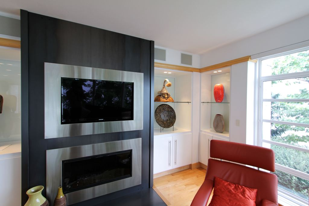 Silver Framed Tv Above Fireplace