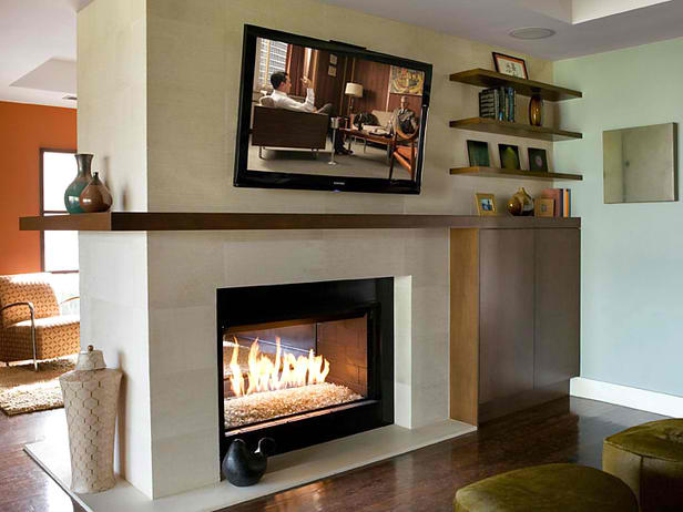 tv above Textured limestone fireplace