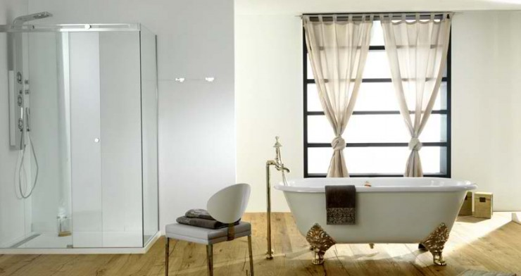 luxury free standing tub with gold  feet Contemporary Bathroom Design by Porcelanosa