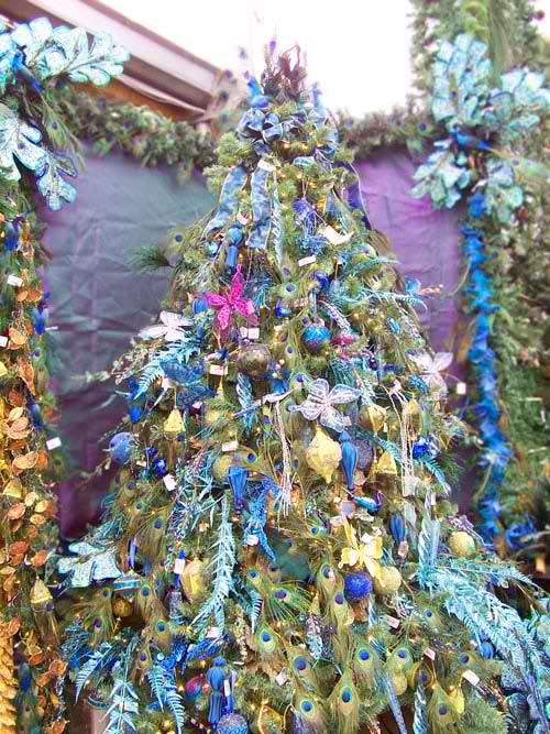 Christmas tree decoration with purple peacock feather and blue