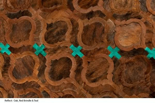 brown and turquoise cow hide rug by kyle bunting