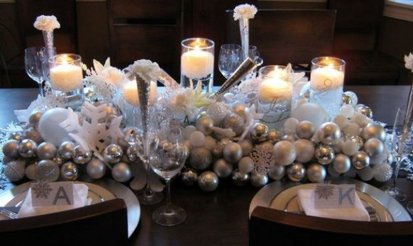 silver christmas balls and candles as centerpiece