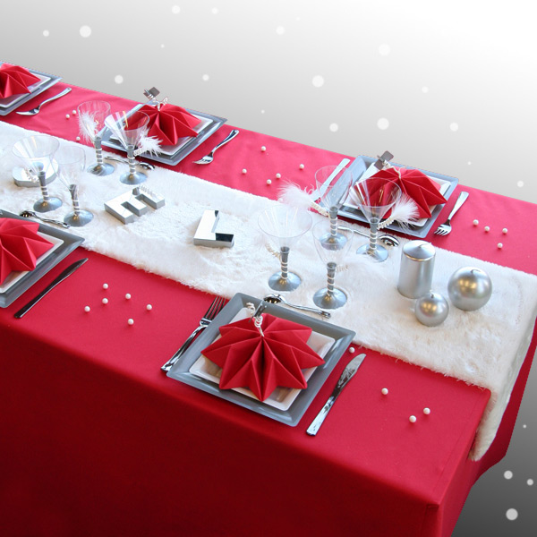 festive table with red and white decorations