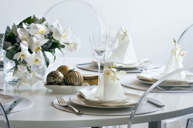 white and golden elements on table decorations