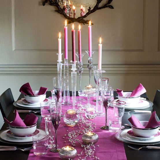 purple candles in candleholders on a table