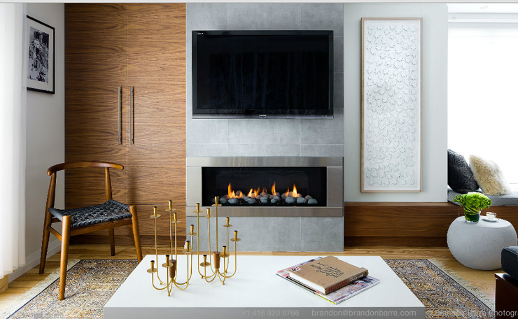 living room with tv above fireplace photo by brandon barre
