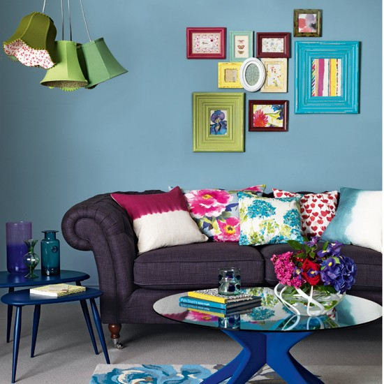 vibrant blue-flocked coffee table gives this traditional living room
