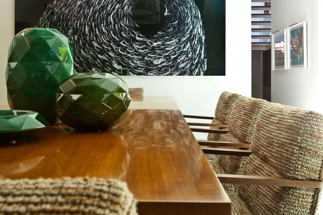contemporary dining room with black painting by Stephanie Wohlner