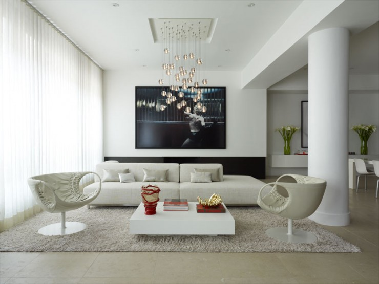 white minimalist living room with black wall art