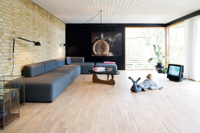 minimalist living room with black and brick walls