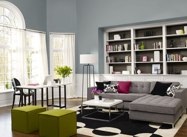 gray sofa with black, purple and black and white pillows