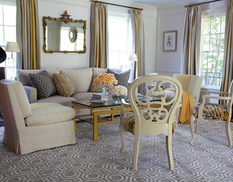 beige armchairs and gray flooring