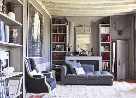 gray living room design with library