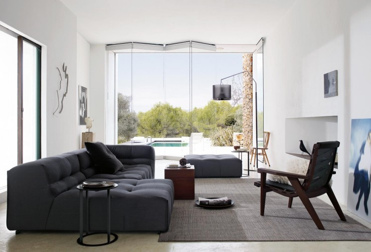 dark gray sofas with gray carpet
