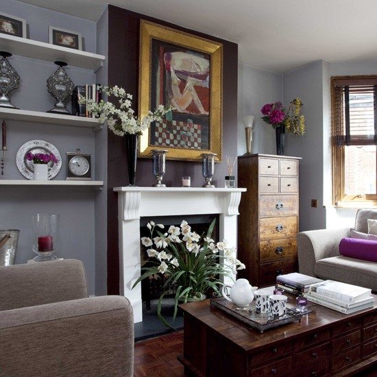 chestnut furniture set against slate gray walls gives this living room
