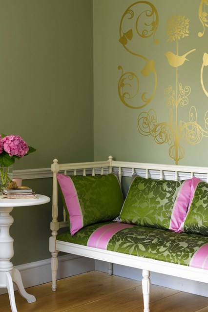 golden design on a olive green wall