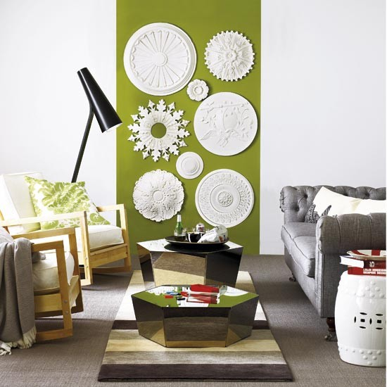iving room with green statement wall design