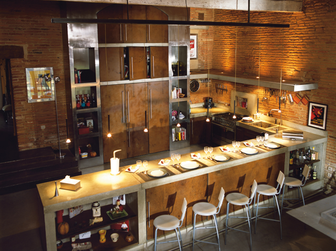 stainless concrete kitchen with brick walls