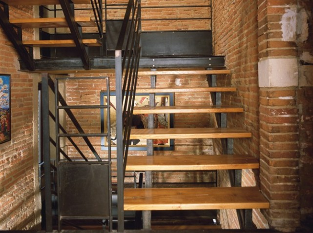 stairs with brick walls