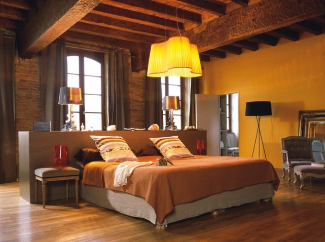 warm bedroom with brick walls