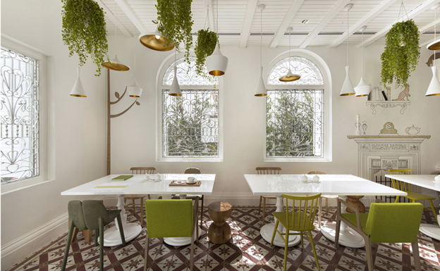 white dining room with hanging plants