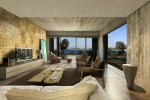 concrete living room by emre arolat with view