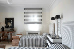 bedroom with blue and white tiles by cadena