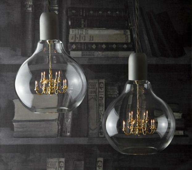chandelier suspended inside a glass lightbulb