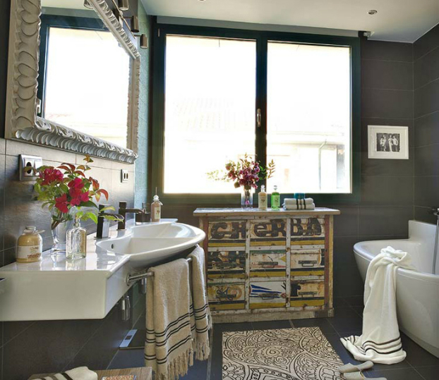 modern bathroom with antique 2 furniture and black tiles