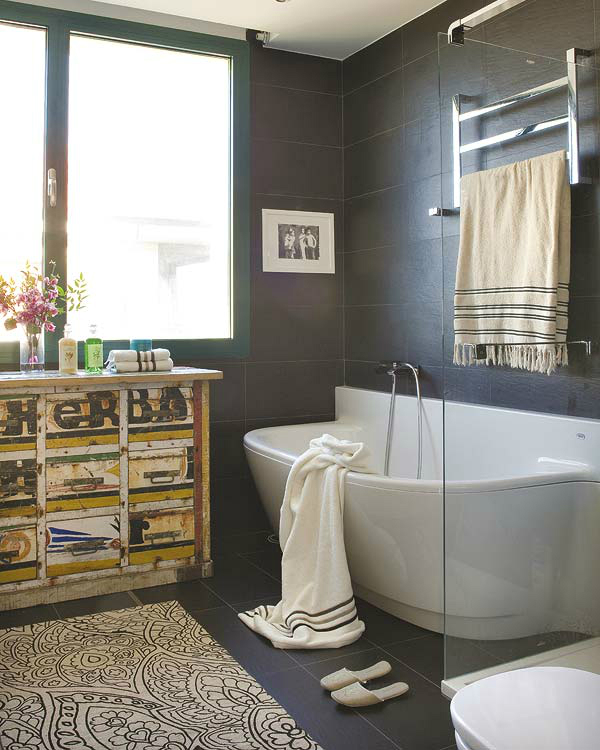 modern bathroom with antique furniture and black tiles