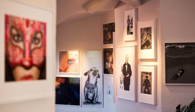 art wall with many framed pictures