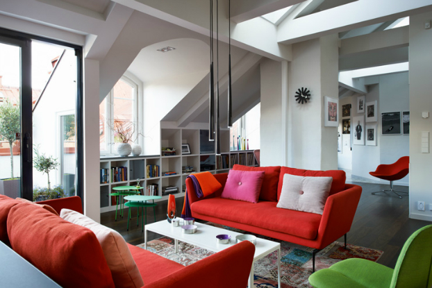 attic living room with red sofas