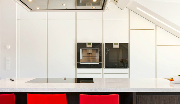 white kitchen with bar and red stools