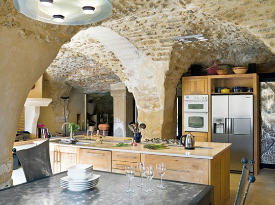Old stone ceiling and contemporary furniture