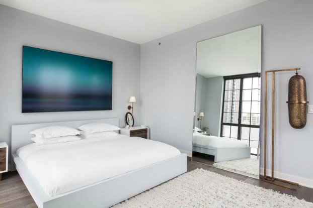 white bedroom with contemporary art