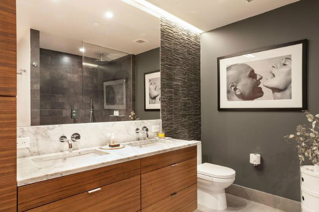 gray contemporary bathroom with wood furniture and art