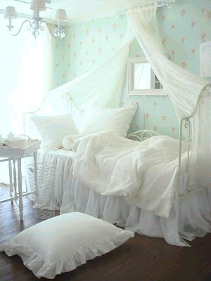 white curtains above bed