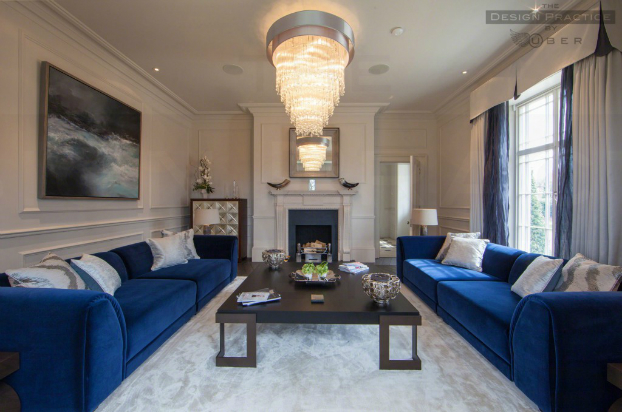 elegnt living room with navy blue velvet sofa by by The Design Practice